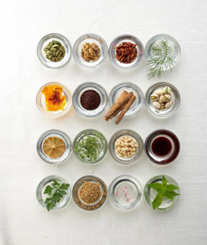Photo: Signature ingredients - Top row (left to right): cardamom, walnuts, dried chiles, dill; second row: saffron, sumac, cinnamon, pistachio nuts; third row: dried limes, oregano, pine nuts, pomegranate molasses; bottom row: parsley, fenugreek, rosewater, mint