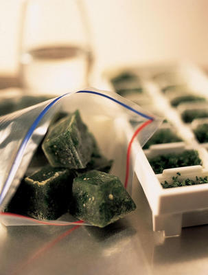 Photo: Make herb ice cubes by washing and drying the herbs well, then chop and freeze them in small pots or ice-cube trays with a little water or oil. Place in plastic bags to store.