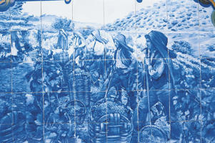 Photo: Painted tiles depicting workers gathering grapes in the vineyard
