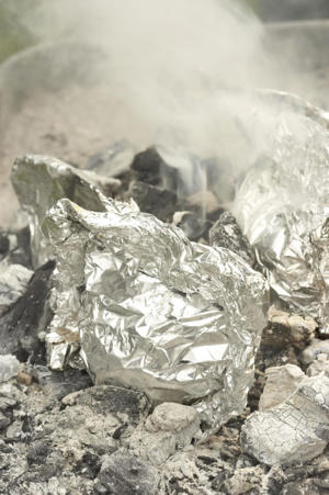 Photo: Ash-roasting in foil - Lots of vegetables grill well, but ash-roasting gives your side dishes a melting, succulent texture to contrast with the seared crust of a grilled steak or chop.