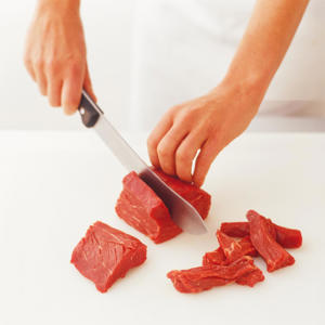 Photo: For cubes, cut fillet steak across the grain into pieces, then cut each piece into slices against the grain. Lay the slices flat, then cut into manageable cubes. Cubes cook quickly and are ideal for sautéing.