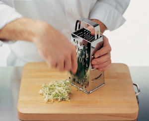 Photo: Rub the vegetable down the length of a grater, choosing the hole size that gives you the size you prefer, or shred in a food processor.