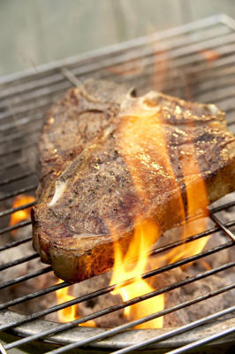 "Photo: Flare-ups are caused when fat drips on to the hot coals. Take away the cause of the problem by moving the food over to the ""dead area"" of the grill, and the flames quickly die down."