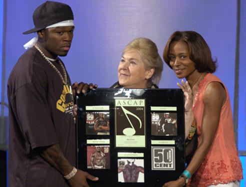 Slide 1 of 20: Songwriter of the Year Award Winner 50 Cent and ASCAP President/Chairman Marilyn Bergman (center) and Jeannie Weems.