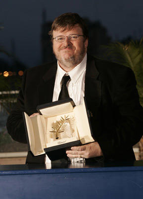 Slide 1 of 28: Michael Moore, Winner of The Palm D'Or