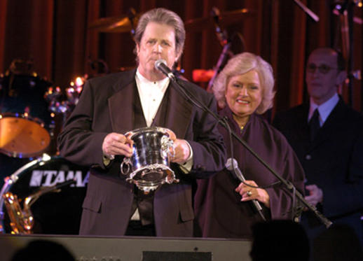 Slide 1 of 27: Brian Wilson recieves the BMI ICON award from Frances W. Preston, BMI President & CEO