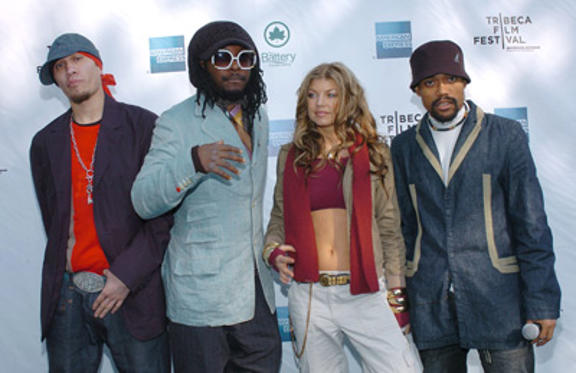 "Slide 1 of 13: The <a href=/artist/?artist=107479 Arg=""107479"" type=""Msn.Entertain.Server.LinkableArtist"" LinkType=""Page"">Black Eyed Peas</a> (l-r) Taboo, wil.i.am, Fergie and apl.de.ap arrive at the American Express Concert in NYC during The 3rd Annual Tribeca Film Festival."