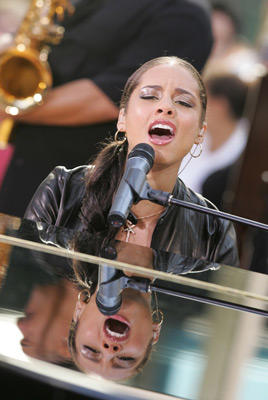 Slide 1 of 9: Alicia Keys