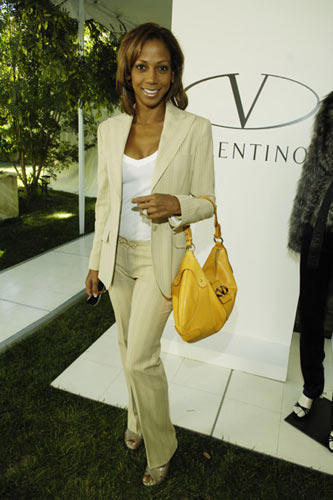 Slide 1 of 9: Holly Robinson Peete at the Valentino and Lorraine Schwartz Fashion Show and Sale to Benefit the Intrepid Fallen Heroes Fund