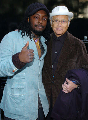Slide 1 of 38: will.i.am of The Black Eyed Peas and Norman Lear backstage the American Express Concert in NYC during The 3rd Annual Tribeca Film Festival.