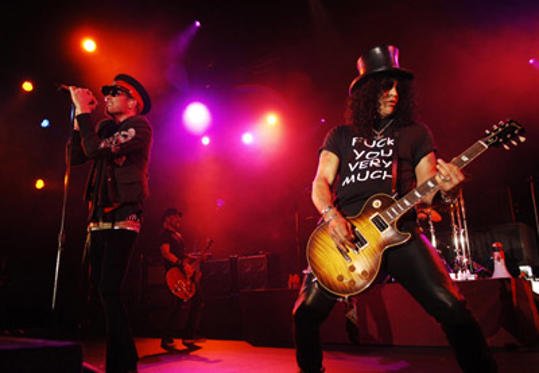 Slide 1 of 31: Scott Weiland and Slash of Velvet Revolver