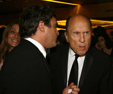 Slide 1 of 14: Joaquin Phoenix and Robert Duvall
