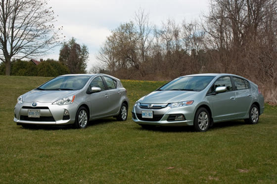 Slide 1 of 24: 2012 Toyota Prius C and Honda Insight