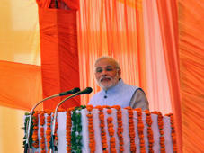 Indian Prime Minister Narendra Modi addresses during a gathering after inaugurating a train on a new stretch of railway to the town of Katra, northwest of Jammu July 4, 2014. Modi saw off the inaugural train on a new stretch of railway to Katra, allowing easier access to the a Hindu shrine there that is one of India's most popular pilgrimage sites and receives upwards of 10 million visitors each year.