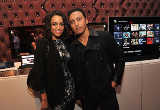 Slide 1 of 34: Laura Izibor and Aasif Mandvi attend the Sony Cierge Holiday Preview at Gansevoort Park Avenue on November 3, 2010 in New York, City.