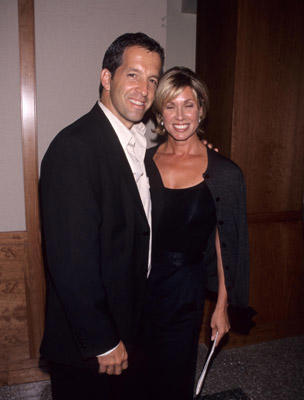 Slide 1 of 4: Kenneth Cole and wife