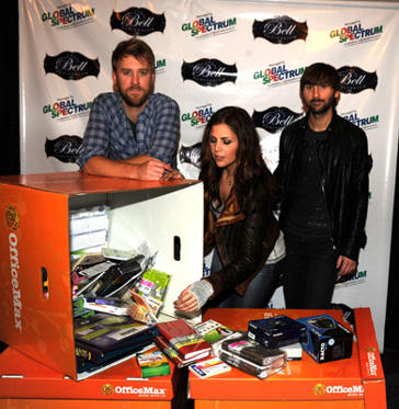 "Slide 1 of 7: (L-R) Charles Kelley, Hillary Scott and Dave Haywood of Lady Antebellum show support for ""A Day Made Better"" cause founded to help erase teacher-funded classrooms. The group members provided Sheila Hancock, Stacey Branch and Jim Tau from Lakeside High School with an award and $3000 worth of school supplies from OfficeMax on November 14, 2010 in Augusta, Georgia."