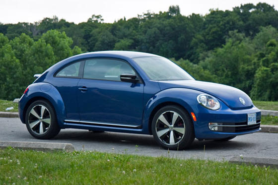 Slide 1 of 17: 2013 Volkswagen Beetle Sportline