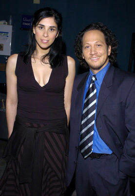 Slide 1 of 23: Host Rob Schneider and Sarah Silverman