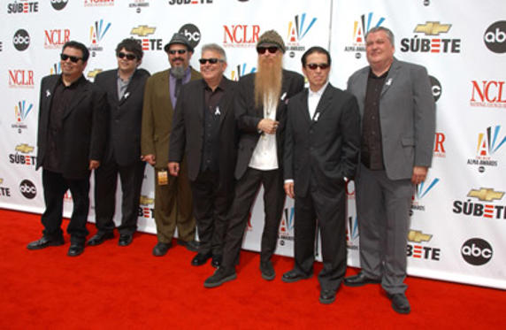 Slide 1 of 143: Billy Gibbons of ZZ Top (third from right) and guests