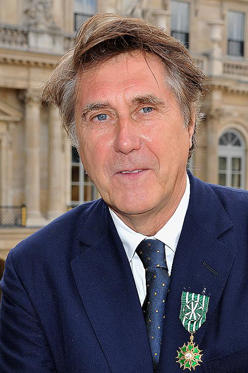 Slide 1 of 1: PARIS, FRANCE - APRIL 04: Bryan Ferry poses after being honored by French Ministerat Ministere de la Culture on April 4, 2012 in Paris, France. (Photo by Pascal Le Segretain/WireImage)
