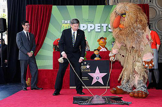 Slide 1 of 11: HOLLYWOOD, CA - MARCH 20: (L-R) The Walt Disney Studios Chairman Rich Ross, Leron Gubler, President/CEO, Hollywood Chamber of Commerce, and Muppet Sweetums attend the Inimitable Muppets Hollywood Walk of Fame Star Ceremony on the Hollywood Walk Of Fame on March 20, 2012 in Hollywood, California. (Photo by Alberto E. Rodriguez/WireImage)