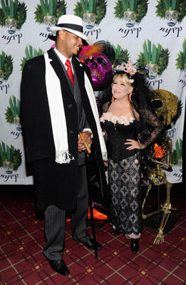 Slide 1 of 43: Carmelo Anthony and Bette Midler attend the 16th Annual Bette Midler's New York Restoration Project's Hulaween at The Waldorf=Astoria on October 28, 2011 in New York City.