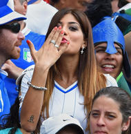 Jenny Darone, wife of Lorenzo Insigne of Italy, blows a kiss during the match be...