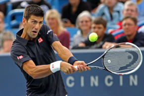 Novak Djokovic returns the serve of Gilles Simon on day two of the Western and Southern Open tennis tournament at Linder Family Tennis Center on August 12, 2014.