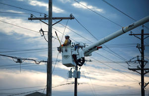Workers with T&D Solutions work to repair power lines in Emerald Isle, N.C.
