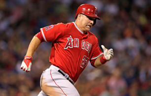 The Los Angeles Angels' Mike Trout dashes down the first base line on an RBI double during the third inning against the Boston Red Sox at Fenway Park in Boston, Monday, Aug. 18, 2014.