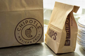 <p>Chipotle Mexican Grill Inc. approached a $700 stock price for the first time on signs that third-quarter sales are growing faster than expected.</p>