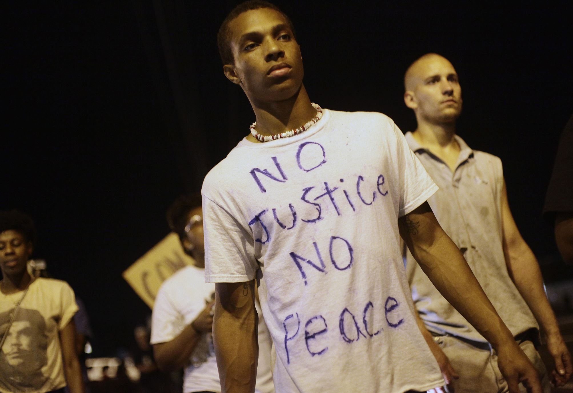 Demonstrators protest the shooting death of Michael Brown Wednesday, Aug. 20, 2014, in Ferguson, Missouri.