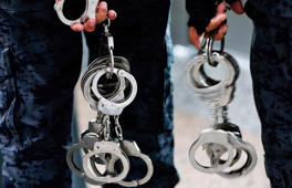 File: Immigration officers carry pairs of handcuffs at Kuala Lumpur International Airport March 12, 2014.