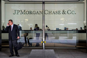 "<span style=""color:#666666;font-family:'Segoe UI', 'Segoe WP', Arial, sans-serif;font-size:13px;line-height:17.992px;""> A man stands outside JP Morgan Chase's corporate headquarters on August 12, 2014 in New York City.</span>"