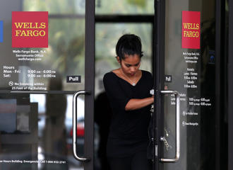 A customer leaves a Wells Fargo Bank branch in Daly City, California.