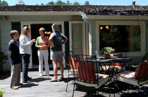 Real estate agents chat at an open house in San Rafael, California.