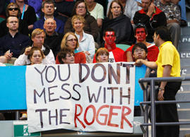 "A security guard asks spectators to remove a ""You Don't Mess With Roger"" banner during the semi-final match between Roger Federer of Switzerland and France's Jo-Wilfried Tsonga at the Australian Open tennis tournament in Melbourne January 29, 2010."