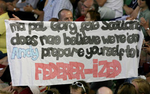 A fan holds up a banner before the start of the men's singles final between Roger Federer of Switzerland and Andy Murray of Britain on day 14 of the Australian Open tennis tournament in Melbourne on January 31, 2010.