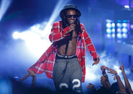 Lil Wayne performs during the 2014 BET Awards in Los Angeles, California June 29, 2014.  REUTERS/Mario Anzuoni  (UNITED STATES-Tags: ENTERTAINMENT)(BETAWARDS-SHOW)