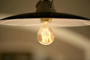 Incandescent Lightbulb in a lamp.    AlexPitt/Getty Images