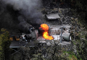 In this Nov. 30, 2010 file photo, flames burn from a ventilation shaft above the Pike River mine which has fatally trapped 29 miners and contractors in Greymouth, New Zealand.