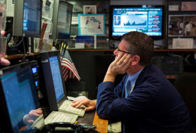 A trader on the floor of the New York Stock Exchange shortly after the start of trading August 11, 2014.
