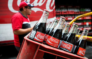 A worker makes deliveries of Coca-Cola products in Mexico City, Mexico.