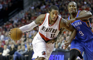 Portland Trail Blazers forward LaMarcus Aldridge, left, drives against Oklahoma City Thunder center Serge Ibaka during the second half of an NBA basketball game in Portland, Ore., Oct. 29.