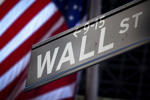 A Wall Street sign is pictured outside the New York Stock Exchange in New York, October 28, 2013.   Carlo Allegri/Reuters