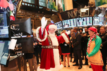 Santa Claus and the 87th Annual Macy's Thanksgiving Day Parade visits the New York Stock Exchange visits at New York Stock Exchange on November 27, 2013 in New York City.