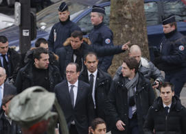 French President Francois Hollande arrives after a shooting at the Paris offices of Charlie Hebdo, a satirical newspaper, January 7, 2015.