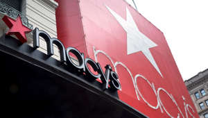 The Macy's Inc. logo is displayed outside of the company's flagship store in New York on Wednesday, Aug. 6, 2014.