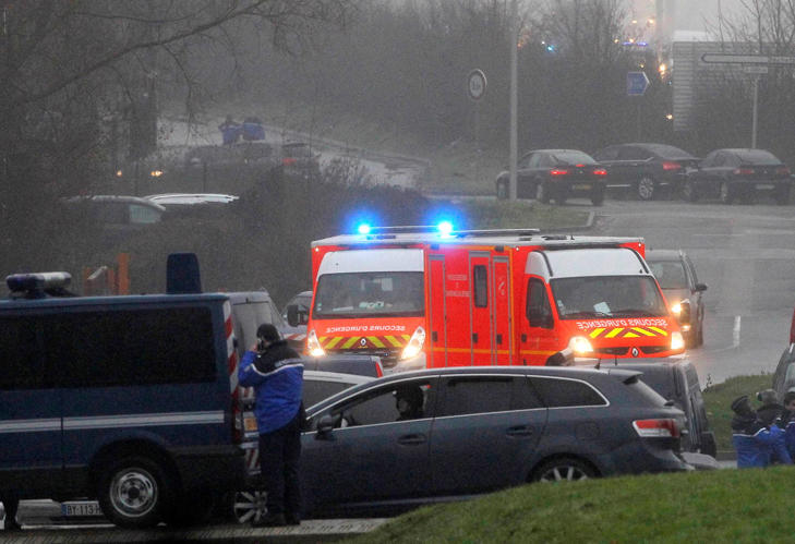 Ambulances try to make their way to Dammartin-en-Goele, northeast Paris, as part of an operation to seize two heavily armed suspects, Jan. 9, 2015.